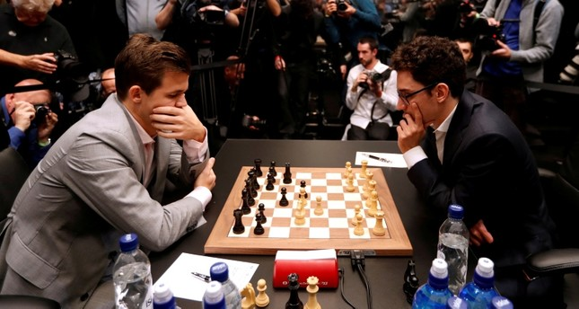 USA's Fabiano Caruana (right) and Norway's Magnus Carlsen (left) during round 12 of the World Chess Championship Final. (Reuters Photo)