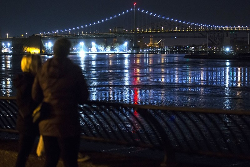 People look at New York City's East River after a helicopter crashed into the water in New York City, New York. (EPA Photo)