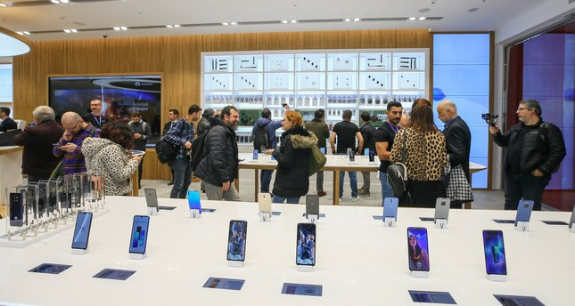 In this file photo, people are seen in a Huawei store in the western province of İzmir, Feb. 2, 2019. AA Photo