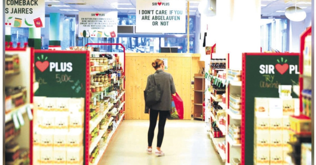 Customer shops at Sir Plus supermarket for surplus, nonstandard and expired food offered at discount prices in Berlin, Germany, Feb. 18, 2019.