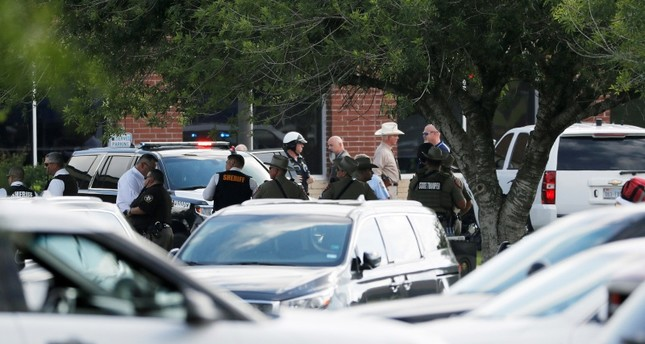 Emergency responders from multiple agencies work at the scene in front of Santa Fe High School in response to a shooting on Friday, May 18, 2018 (AP Photo)