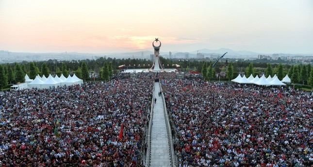A handout photo made available by the presidential press office shows a mass of people during a ceremony to mark the first anniversary of the failed coup attempt on 15 July, at the presidential palace in Ankara, Turkey early 16 July 2017.