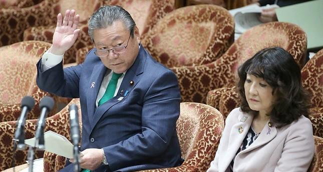 This Nov. 14, 2018 photo shows Yoshitaka Sakurada (L) raising his hand to answer a question beside Satsuki Katayama (R), minister in charge of regional revitalization and female empowerment, during a parliament session in Tokyo. (AFP Photo)