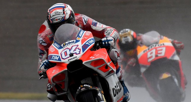Ducati rider Andrea Dovizioso of Italy (L) leads Honda rider Marc Marquez of Spain (R) during the MotoGP Japanese Grand Prix at Twin Ring Motegi circuit in Motegi.