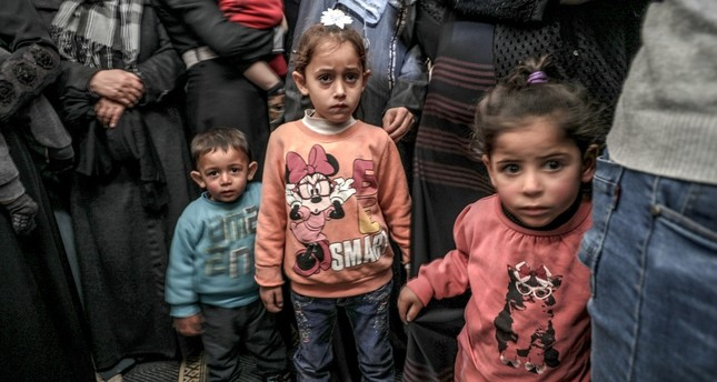 Palestinians child relatives of four-year-old Ahmed Abu Abed look on during his funeral at east Khan Younis town in the southern Gaza Strip, Dec. 12.