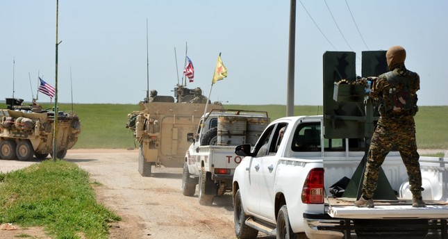 A U.S. military convoy and terrorists from the People's Protection Units (YPG), an extension of the PKK, patrolling near the Syrian town of al-Darbasiyah at the Syrian-Turkish border, April 29.