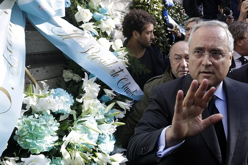 Lazio soccer team president Claudio Lotito gives a statement to the press after laying a wreath outside Rome's Synagogue (AP Photo)