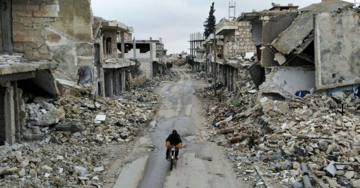 An aerial picture taken Feb. 15, 2020, shows a Syrian man on a motorbike in the deserted Syrian city of Kafranbel, south of Idlib city in the eponymous northwestern province, amid an ongoing pro-regime offensive. (AFP Photo)