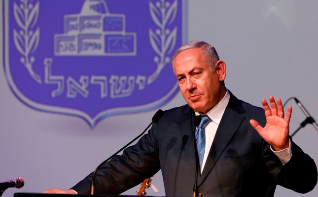 Israeli Prime Minister Benjamin Netanyahu gestures as he speaks during the annual GPO (government press office) New Year's toast in Jerusalem on December 12, 2018. (AFP Photo)