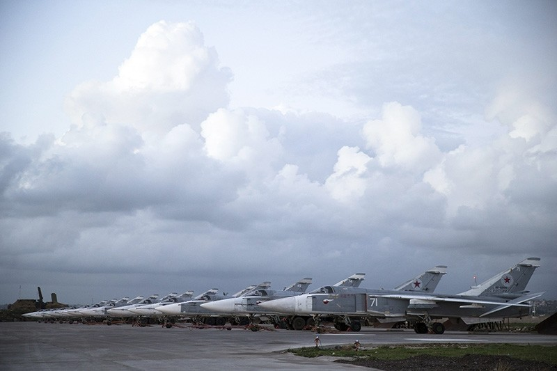 Russian bombers parked at Hemeimeen air base in Syria, Friday, March 4, 2016. (AP Photo)