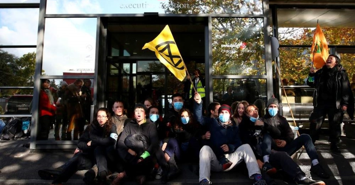 Extinction Rebellion climate change activists block an entrance to the general aviation terminal at the Geneva Airport, Switzerland, Nov. 16, 2019 (Reuters)