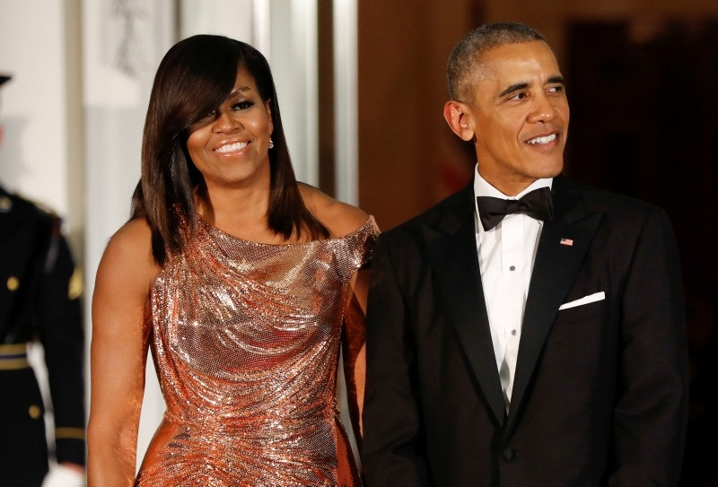In this Oct. 8, 2016 file photo, President Barack Obama and first lady Michelle Obama wait to greet Italian Prime Minister Matteo Renzi and his wife Agnese Landini for a State Dinner at the White House in Washington. (AP Photo)