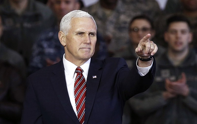 U.S. Vice President Mike Pence gestures after addressing U.S. military members and Japan's Self-Defense Force (JSDF) before he departs for South Korea, at Yokota U.S. Air Force Base in Fussa, on the outskirts of Tokyo, Japan. (Reuters Photo)