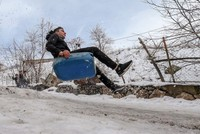Slippery, snowy fun for children of Van