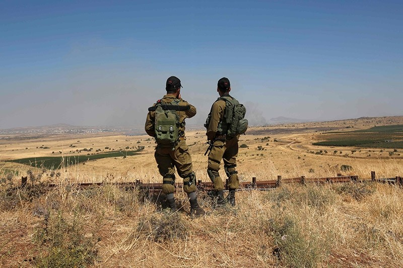 Israeli soldiers patrol near the border with Syria after projectiles fired from the war-torn country hit the Israeli occupied Golan Heights on June 24, 2017. (AFP Photo)