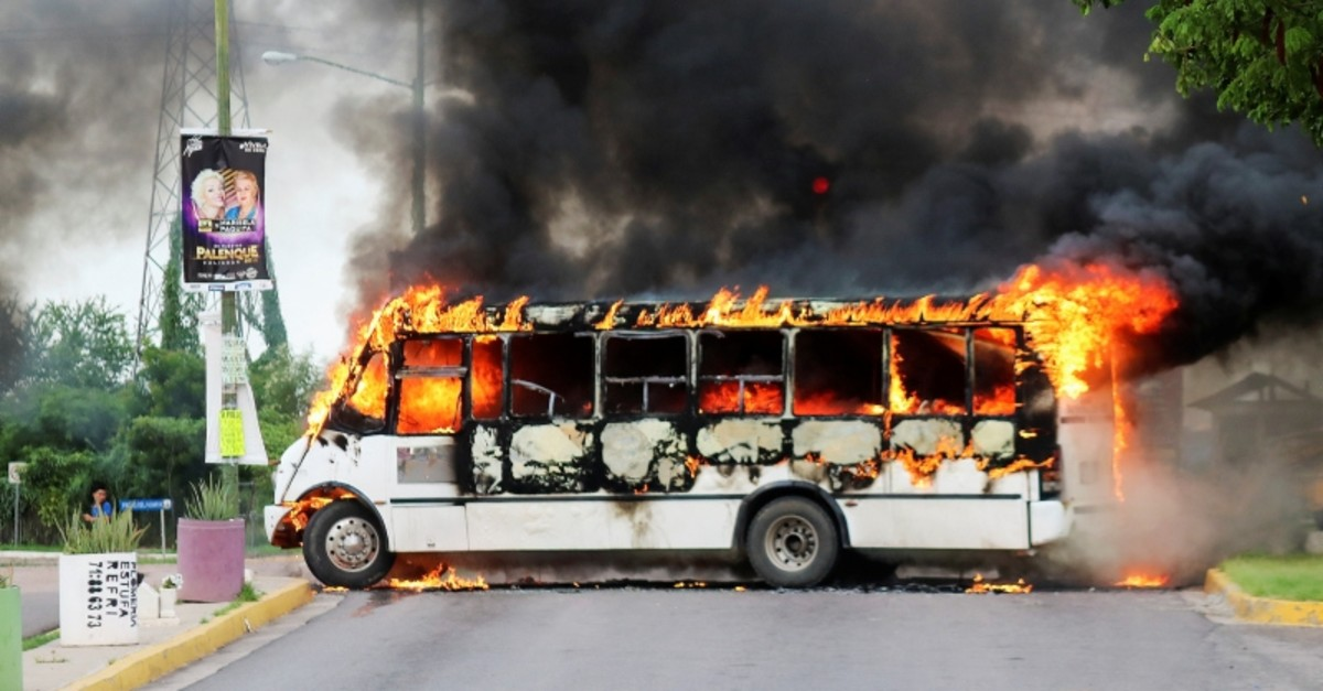 A burning bus, set alight by cartel gunmen to block a road, is pictured during clashes with federal forces following the detention of Ovidio Guzman, son of drug kingpin Joaquin ,El Chapo, Guzman, in Culiacan, Mexico, Oct. 17, 2019. (Reuters Photo)