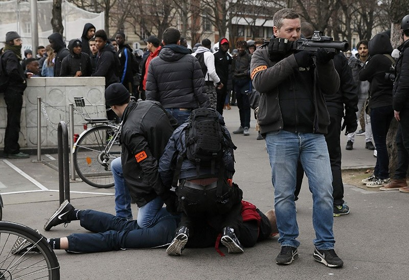 French plainclothes police apprehend a youth during a demonstration against police brutality after a young black man was severely injured during his arrest earlier this month, in Paris, France on Feb. 23, 2017. (Reuters Photo)