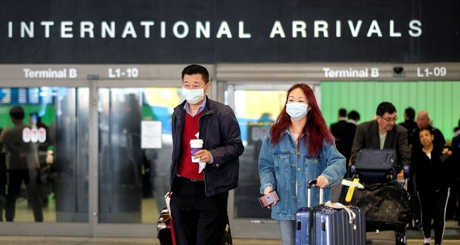 Passengers leave LAX after arriving from Shanghai, China, after a positive case of the coronavirus was announced in the Orange County suburb of Los Angeles, Jan. 26, 2020. Reuters Photo