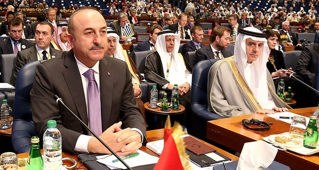 Foreign Minister Mevlüt Çavuşoğlu (L) and then-Saudi Foreign Minister Adel al-Jubeir attend the second day of an international conference for reconstruction of Iraq, in Kuwait City, on Feb. 14, 2018. (AFP Photo)