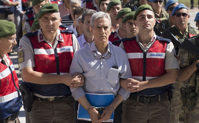 Soldiers escort Akın Öztürk, the former general accused of leading coup plotters, to a courtroom in Ankara, Aug. 2, 2017.