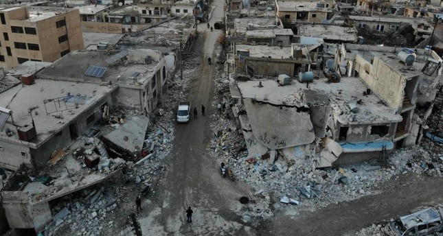 An aerial view shows the damage caused by the reported Syrian regime and Russian airstrikes in the town of Al-Bara in the south of Syria's Idlib province, Dec. 8, 2019. AFP