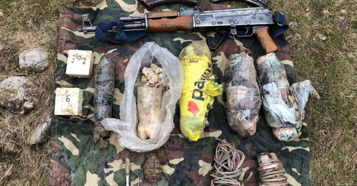 Weapons and ammunition seized from PKK shelters during anti-terror operation in Hakkari on Wednesday, March 13, 2019. (AA Photo)