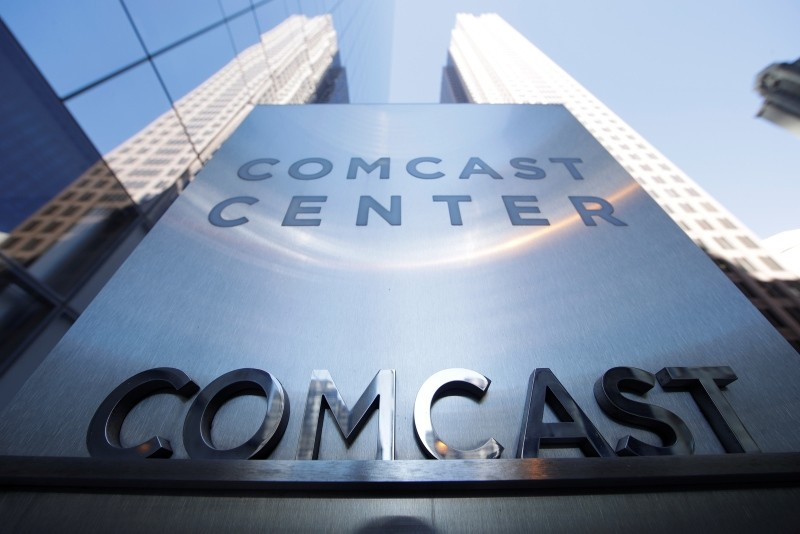 This March 29, 2017, file photo shows a sign outside the Comcast Center in Philadelphia. Comcast made a $65 billion bid Wednesday for Fox's entertainment businesses, setting up a battle with Disney to become the next mega-media company. (AP Photo)