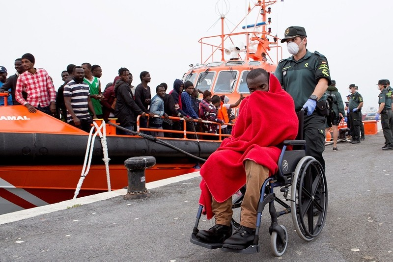 Some of the 53 rescued migrants are carried ashore in Motril, Granada, southern Spain, 15 June 2018. (EPA Photo)