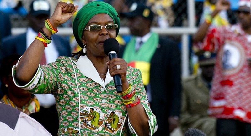 Grace Mugabe raises her fist as she addresses at a rally in Harare on July 28, 2013. (Photo via Alexander Joe/AFP/Getty Images)