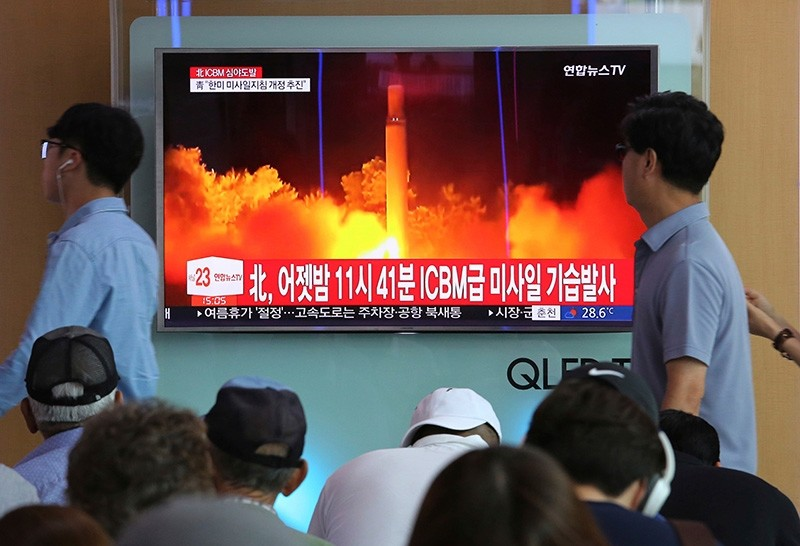 In this July 29, 2017 file photo, People watch a TV news program showing an image of North Korea's latest test launch of an intercontinental ballistic missile (ICBM), at the Seoul Railway Station in Seoul, South Korea. (AP Photo)
