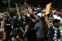 Protesters clash with US police over shooting of unarmed disabled black man