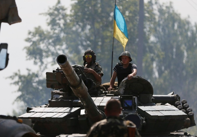 Ukrainian soldiers look out from a tank at a position some 60 km from the eastern Ukrainian city of Donetsk, July 10, 2014. (Reuters Photo)