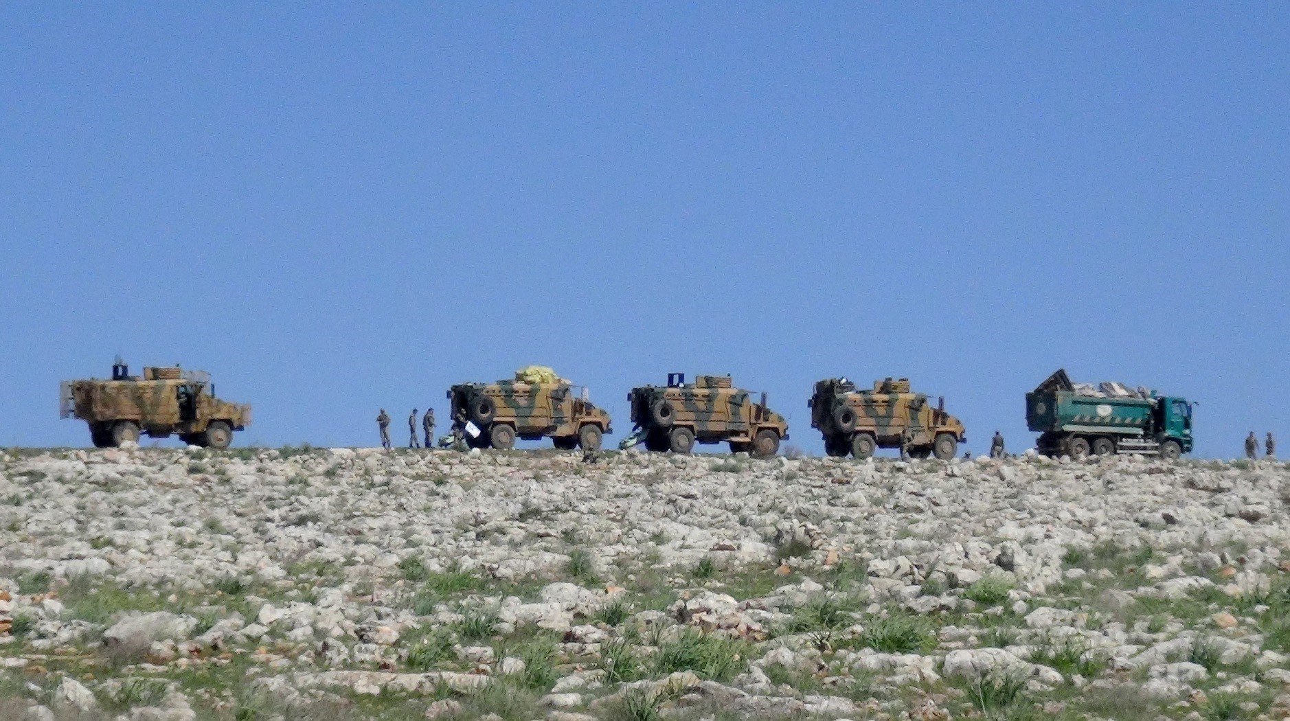 A Turkish military convoy en route to Idlib to establish a monitoring post in the assigned de-escalation zone, March 17.