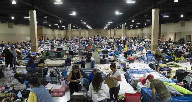 Hundreds of people gather in an emergency shelter at the Miami-Dade County Fair Expo Center in Miami, Florida, September 8, 2017, ahead of Hurricane Irma (AFP Photo)