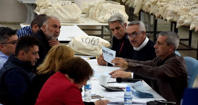 Representatives from various political parties and the YSK recount votes in the Şişli district of Istanbul, April 5, 2019.
