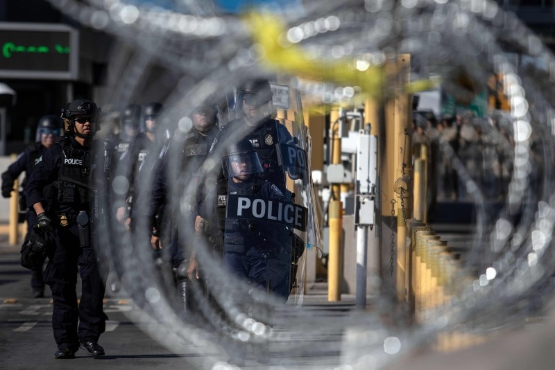 US Customs and Border Protection agents carry out an ,operational readiness exercises, at the San Ysidro port of entry in the US, as seen from Tijuana, Baja California State, Mexico, on January 10, 2019. (AFP Photo)