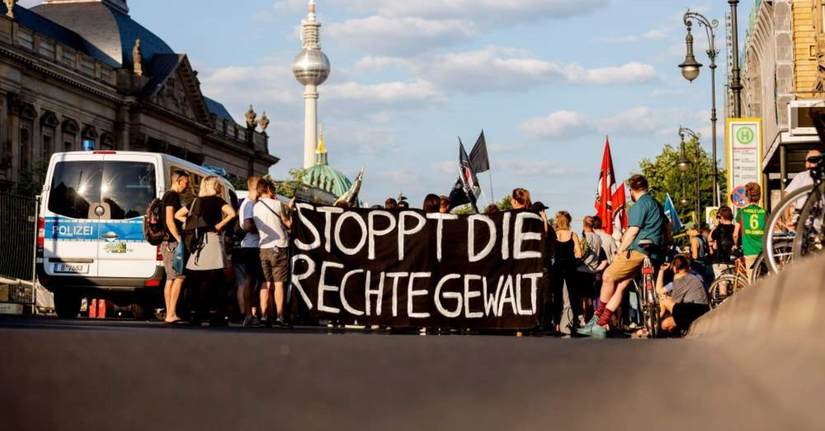 People hold up a banner that reads ,Stop the right-wing violence, during a march, Berlin, June 18, 2019.