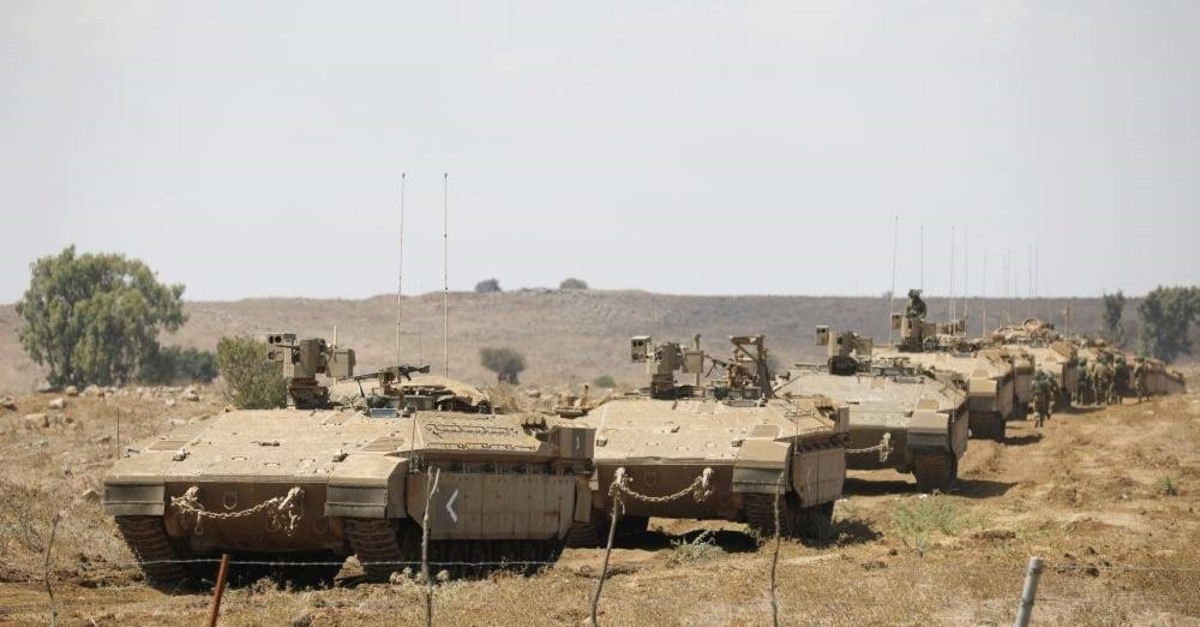 Israeli armored vehicles take part in an army drill in the occupied Golan Heights, Aug. 7, 2018. (REUTERS Photo)