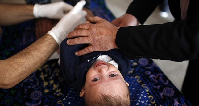A child is being circumcised (File photo / Reuters)