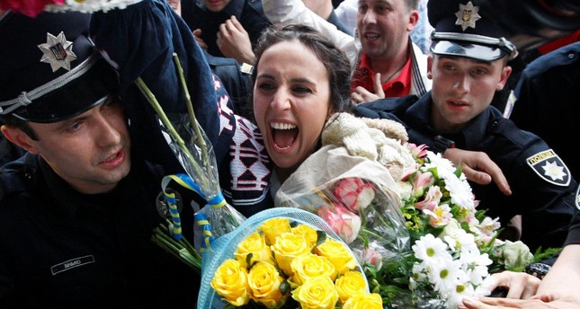 Crimean Tatar singer Susana Jamaladinova, known as Jamala, who won the Eurovision Song Contest, reacts at a welcoming ceremony upon her arrival at Boryspil International Airport outside Kiev.