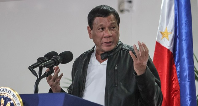 Philippine President Rodrigo Duterte gestures as he speaks shortly after arriving in Davao on May 16, 2017, from a working visit to China. (AFP Photo)