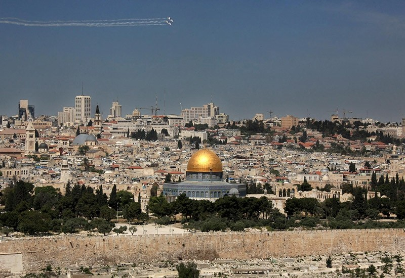 A file picture dated 18 April 2010 shows a view of the Old City of Jerusalem as seen form the Mount of Olives in East Jerusalem as an acrobatic Israeli flying team flys over the city. (EPA Photo)