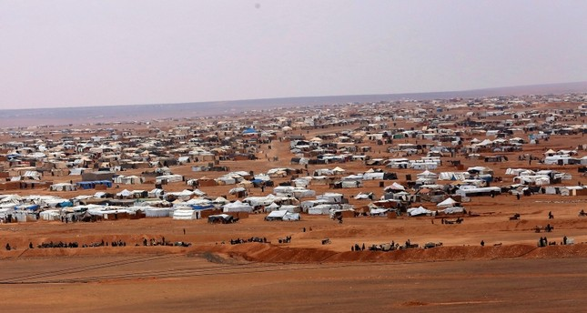 This file picture taken Tuesday, Feb. 14, 2017, shows an overview of the informal Rukban camp, between the Jordan and Syria borders. (AP Photo)