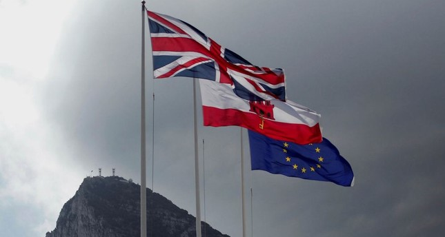 The United Kingdom flag, the Gibraltarian flag and the European Union flag are seen flying at the border of Gibraltar with Spain.