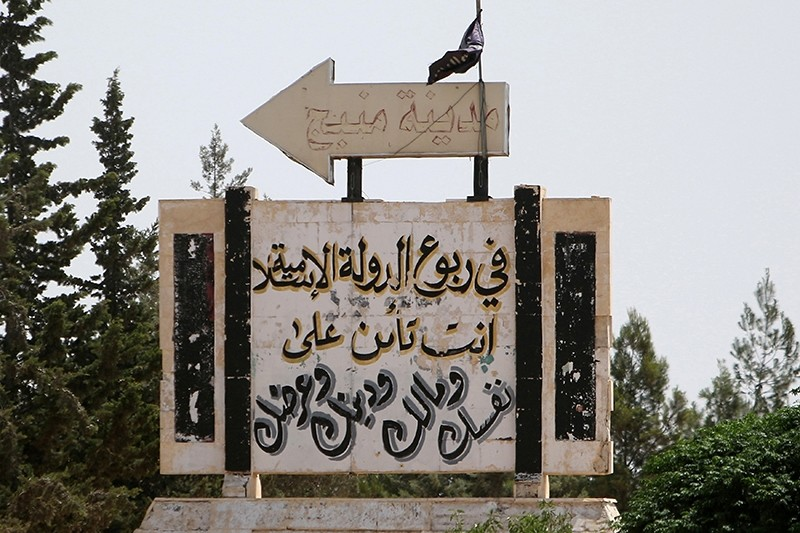 A road sign shows the direction to Manbij city, as seen from the western entrance of the city, in Aleppo Governorate, Syria June 19, 2016 (Reuters Photo)