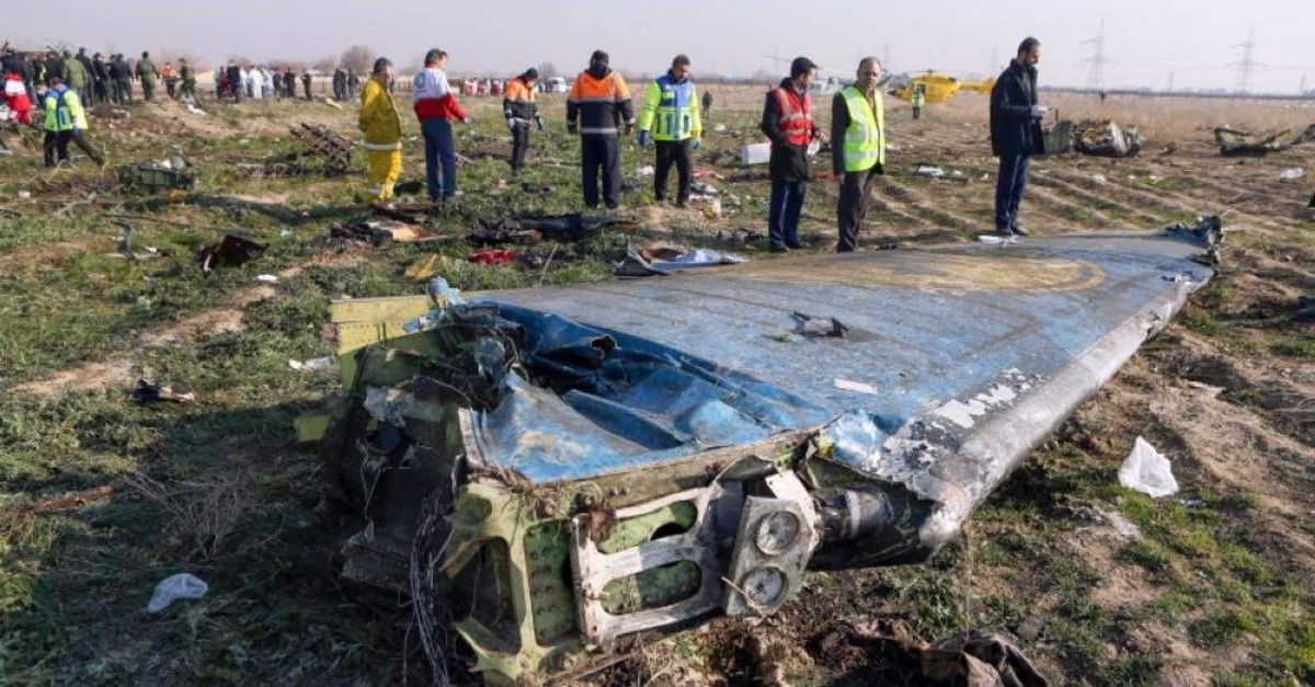 This file handout photo provided by the IRNA news agency shows rescue teams work at the scene of a Ukrainian airliner that crashed shortly after takeoff near Imam Khomeini Airport in the Iranian capital Tehran, on Jan. 8, 2020. (Photo by Akbar TAVAKOLI / IRNA / AFP)