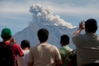 Bali volcano alert level lowered, evacuees allowed to return home