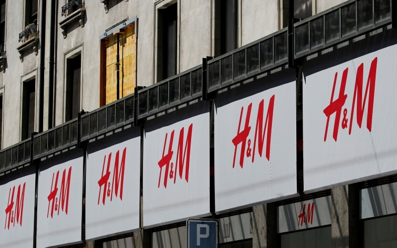 Logos of H&M are pictured on a store in Geneva, Switzerland, August 16, 2018. (Reuters Photo)