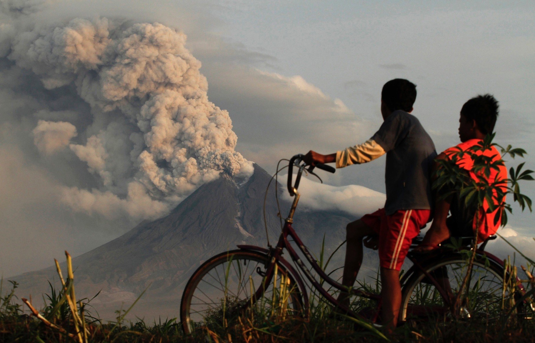 Two local boys look in awe as Mount Merapi erupts in Manisrenggo, Indonesia on Nov. 10, 2010.