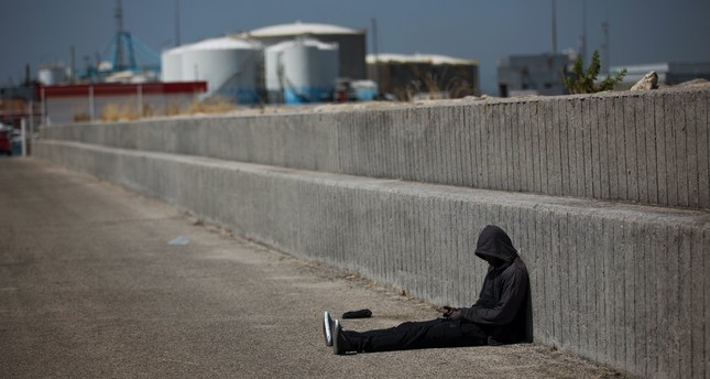 A migrant rests at the port of Algeciras, Spain, after being rescued in the Strait of Gibraltar.